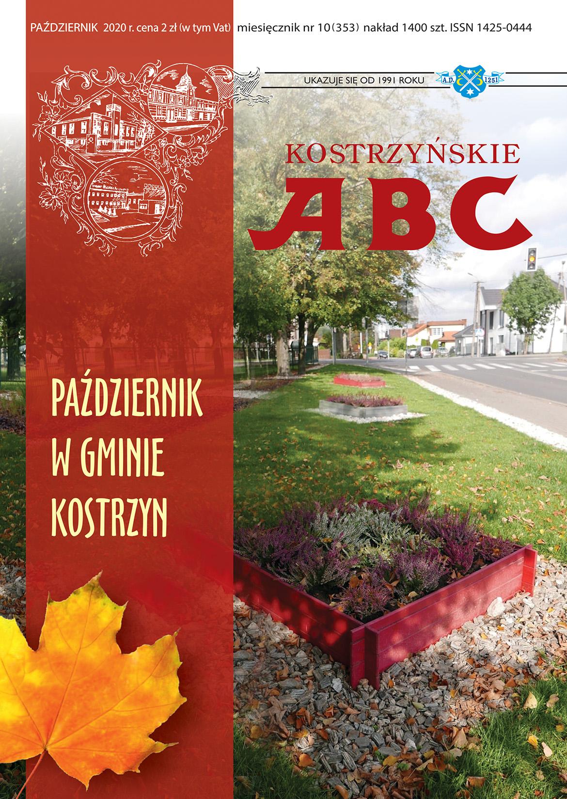 Okładka październikowego numeru przedstawiajaca fragment trawnika przy ul. Piasta i napis Październik w gminie Kostrzyn